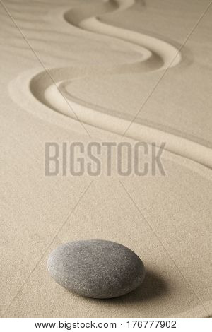zen meditation stone and sand, sheng fui Buddhism in a spiritual japanese rock garden. Abstract harmony and balance concept for purity concentration spa relaxation.