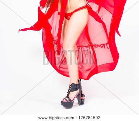 Body parts Long High Heels legs. Dancer in red bathrobe.
