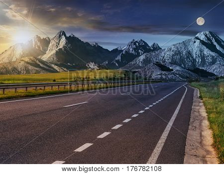 Day and nigght change Travel destination concept image. Composite landscape of High Tatra mountain ridge. Straight asphalt highway through green hills leads to high peaks.