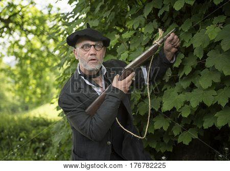Mature French resistance soldier with in a riffle