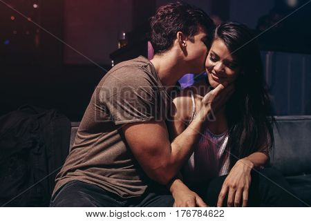 Romantic young couple at the night club. Young couple enjoying in the party at pub.