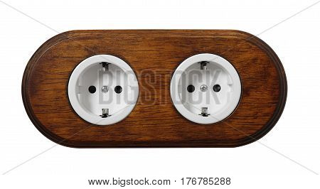 The double wooden electric socket with grounding on a white background