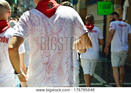 Mans in traditional clothing in wine, San Fermin festival, 06 July 2016, Pamplona, Navarra, Spain.