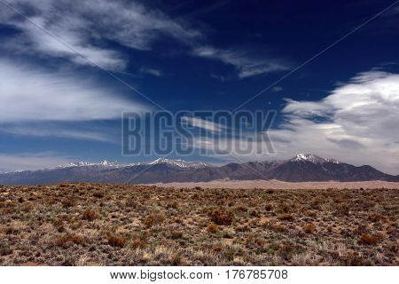 High plains of the San Luis Valley looking toward the mountains and the Great Sand Dunes National Park near Alamosa, Colorado