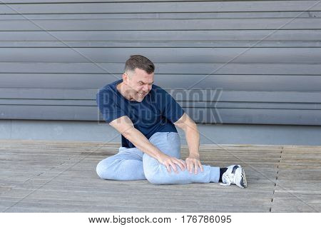 Sporty Middle-aged Man With Muscle Cramps