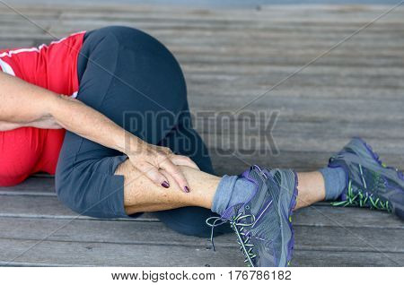Senior Woman Suffering From Leg Cramps