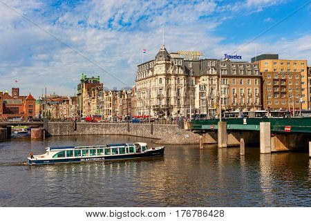 AMSTERDAM, NETHERLANDS - JULY 07, 2015: View of city center in Amsterdam - capital city and most populous in Netherlands, popular tourist destination with more than 5 million visitors annually.