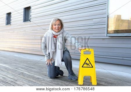 Elderly Woman Crawling On Her Knees After Slipping