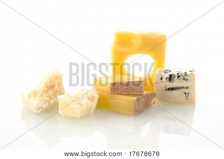 Various cheese types isolated on white background. Emmentaler pargmiano and blue cheese and other. poster
