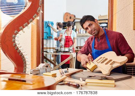 Young man as trainee learning on his grinding lesson