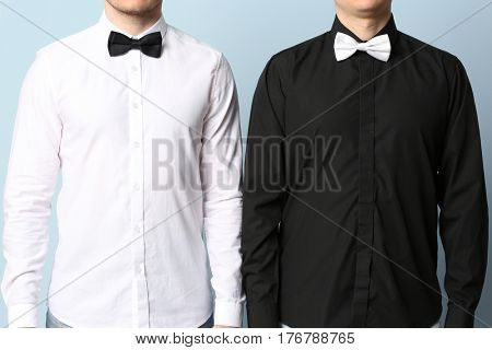 Gay couple on color background
