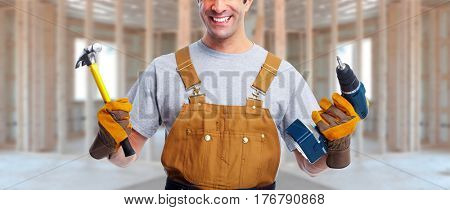worker with drill and hammer