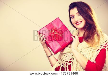 Girl checking out present. Young attractive woman holding gift box. Christmas santa holidays celebration relax concept.