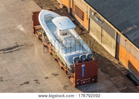Victoria Mahe island Seychelles - December 15 2015: A white speedboat in the container on the dock of Port Victoria Mahe island Seychelles.