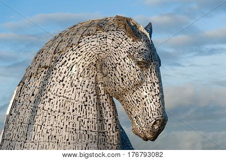 FALKIRK SCOTLAND - DECEMBER 13 2013: The head of a Kelpie horse sculpture at The Helix Park in Falkirk Scotland. The Kelpie structures are the work of artist Andy Scott.