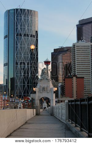 lion statue above the centre street bridge in with a partial view of downtown Calgary Alberta