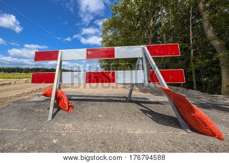 Red And White Roadblock In Perpective