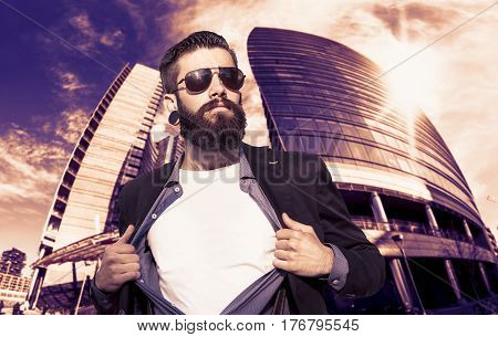 Young Hipster Superhero Is Protecting The City In Front Of A Skyscraper