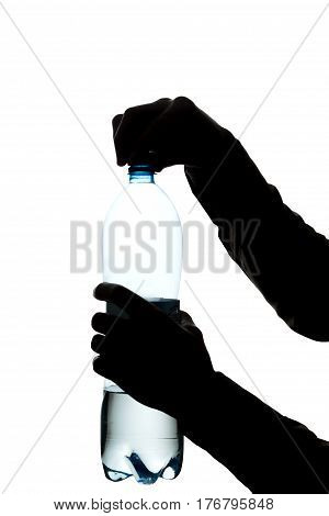Male Hands Open A Bottle Of Water To Drink - Silhouette
