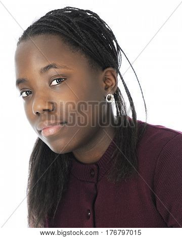 Head and shoulders image of a beautiful black tween girl.  On a white background.