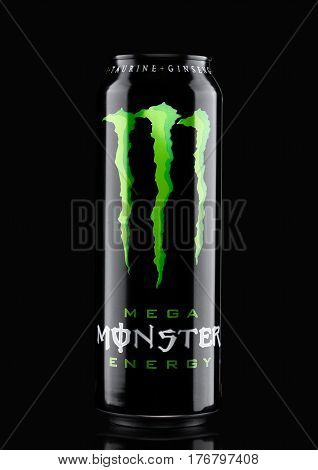 London, Uk - March 15, 2017:  A Can Of Monster Energy Drink On Black. Introduced In 2002 Monster Now