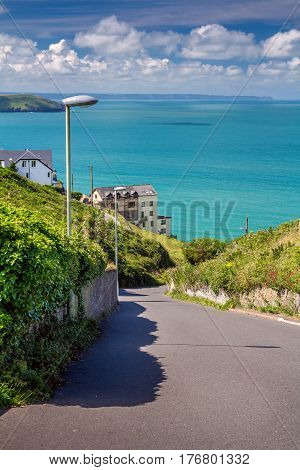 The road between Woolacombe and Mortehoe. In the background you can see the sea bay and the house. Good warm weather. Summer. North Devon. England