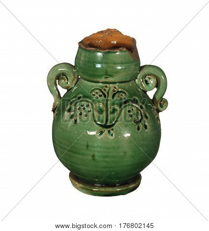 Old ceramic vase of green color with a broken top isolated on white background.