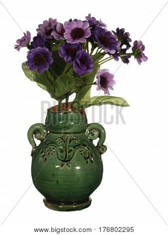 Old ceramic vase of green color with artificial violet flowers isolated on white background.