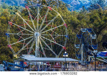Two Ferris Wheels In Foothills In California