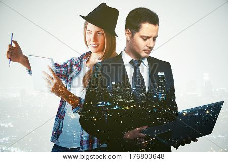 Young female artist and businessperson with notebook on night city background. Double exposure. Creative and analytical thinking concept