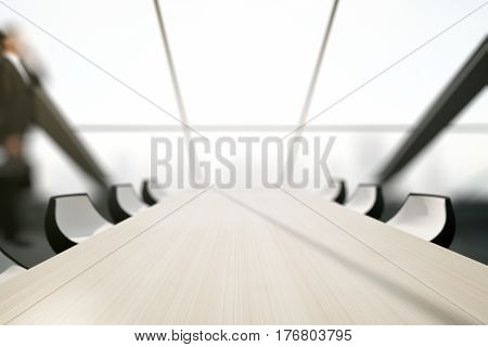 Close up of light wooden conferece table in interior with blurry city view. Mock up 3D Rendering