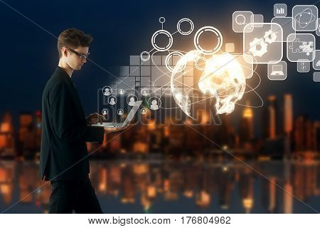 Side view of young businessman using laptop with digital financial charts icons and globe. Blurry night city background. Online business concept. 3D Rendering