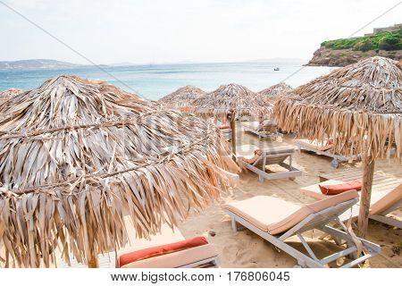 Sun beds and umbrellas on the sandy beach near the sea