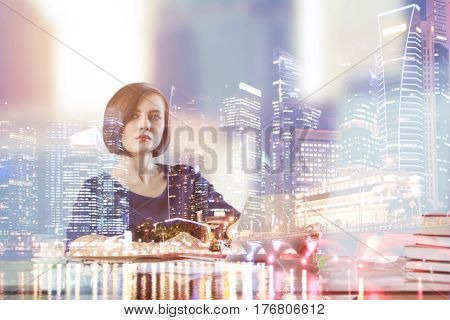 Attractive young female at workplace. Abstract city background. Overworked concept. Double exposure