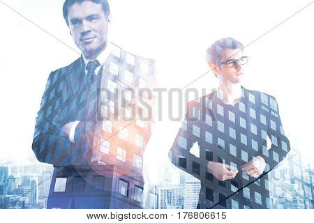 Two handsome businessmen on creative city background. Double exposure. Employment concept