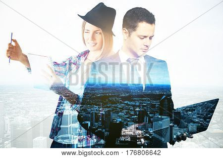 Young female artist and businessman with laptop on city background. Double exposure. Creative and analytical thinking concept