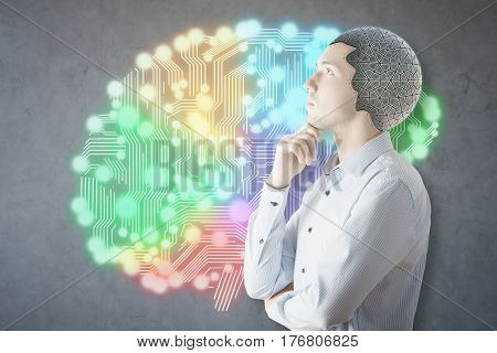 Side view of man with colorful robotic brain on concrete background. Brain storm concept