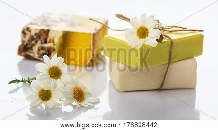 Handmade Soap Bars And Chamomile On White Background