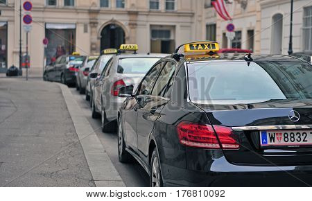 VIENNA AUSTRIA - FEBRUARY 11: Taxi cars in the street of Vienna on February 11 2017. Vienna is a capital and largest city of Austria.
