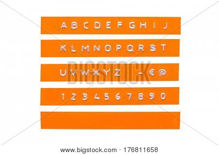 embossed alphabet on orange plastic tape, isolated on white