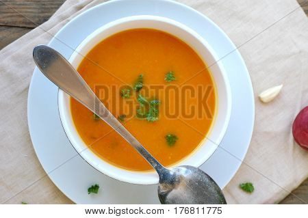 Healthy Orange Soup From Pumpkin Hokaido, Green Celery, Garlic, Onion And Parsley In Boxl With Spoon