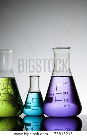 group of laboratory flasks with liquid inside