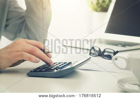 Accountant Calculates Tax. Working In The Office With Calculator