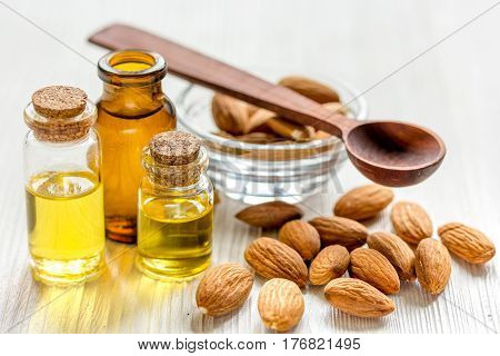 natural cosmetic and therapeutic almond oil for treatment on light wooden background