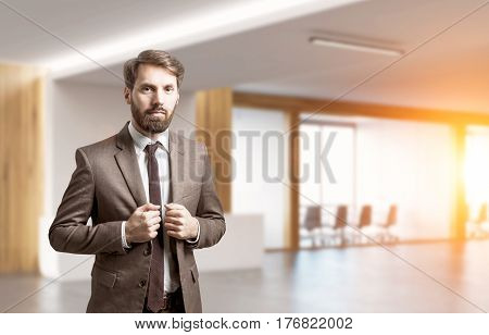 Bearded Businessman In Office Lobby