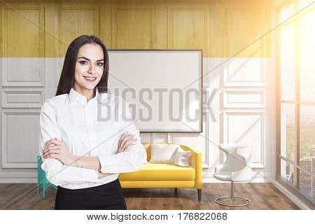 Portrait of a black haired businesswoman standing in a yellow room with a whiteboard. Mock up