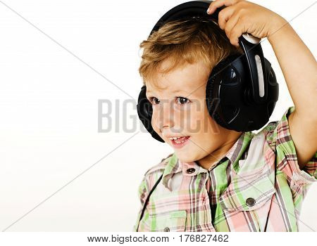 young pretty little cute boy kid wondering, posing emotional face isolated on white background, gesture happy smiling close up, wearing headphones, lifestyle real people concept