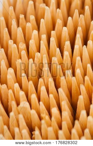 vertical top view macro close up of wooden bamboo toothpicks pattern with selective focus