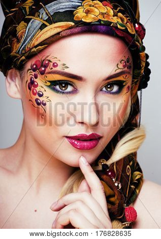 portrait of contemporary noblewoman with face art creative close up, russian style real fashion