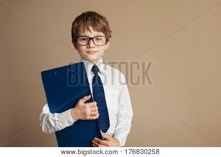 Portrait of a big confident smart boy wearing classic shirt and glasses. School uniform. Education. Copy space.